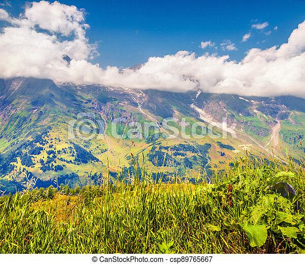 Foggy morning view of Grossglockner mountain range from Grossglockner High Alpine Road - csp89765667