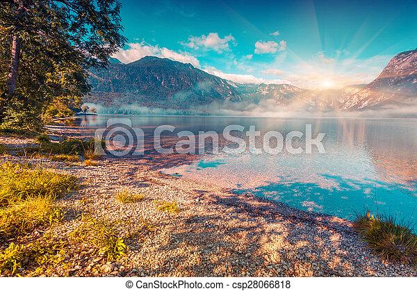 Foggy summer morning on the Bohinj lake - csp28066818