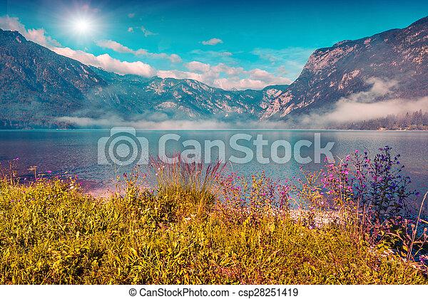 Foggy summer morning on the Bohinj lake. - csp28251419