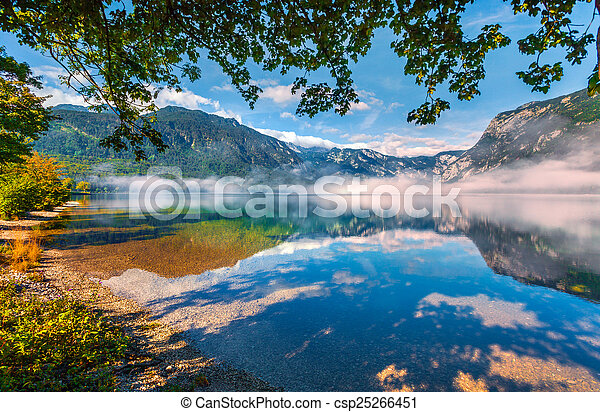 Foggy summer morning on the Bohinj lake - csp25266451