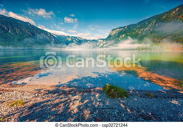 Foggy summer morning on the Bohinj lake - csp32721244