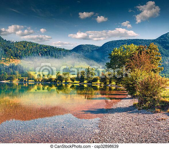 Foggy summer morning on the Bohinj lake - csp32898639