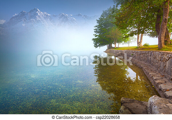 Foggy summer morning on the mountain lake - csp22028658
