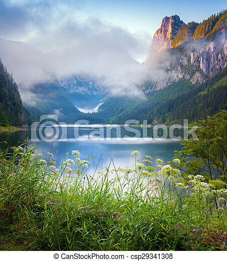 Foggy summer morning on the Vorderer Gosausee lake - csp29341308