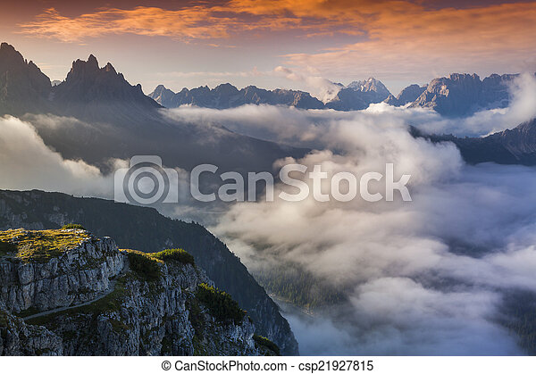 Foggy summer sunrise in the Italian Alps. Dolomites mountains, I - csp21927815