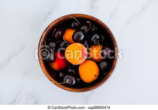 fond, nourriture, simple, abricots, cerises, marbre, bois, frais, bol, ingrédients - csp88800474