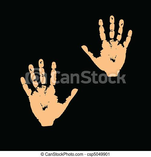 Las manos en un fondo negro - csp5049901