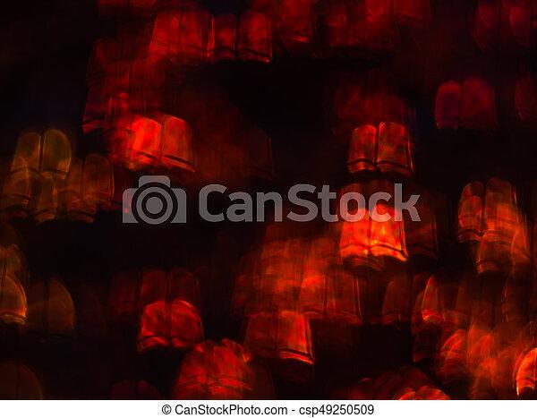 Hermoso fondo con diferentes libros de colores, antecedentes abstractos, formas de libros sobre fondo negro - csp49250509