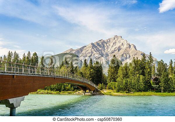 Foot bridge in Banff, Alberta, Canada - csp50870360