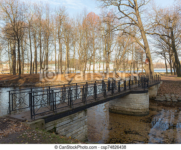 foot bridge in the autumn park - csp74826438