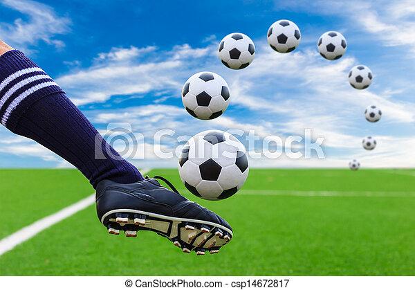 foot kicking soccer ball - csp14672817