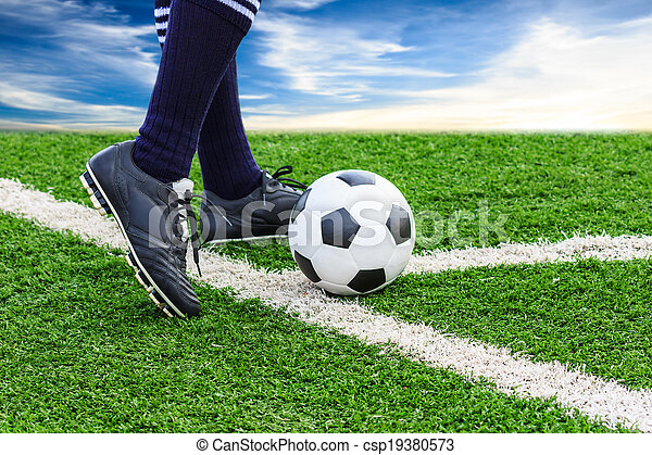 foot kicking soccer ball - csp19380573