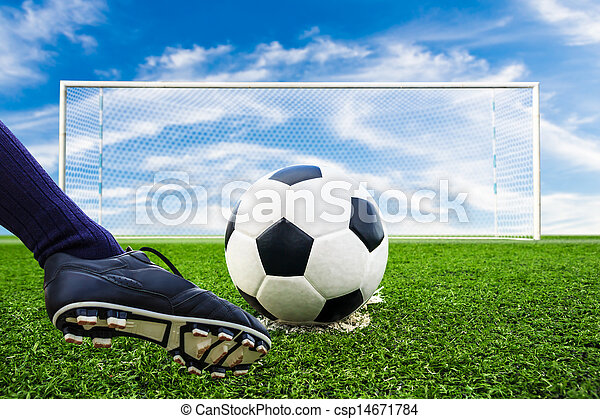 foot kicking soccer ball - csp14671784