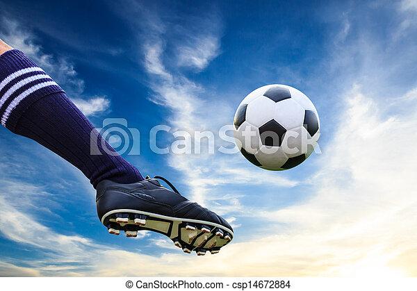 foot kicking soccer ball - csp14672884
