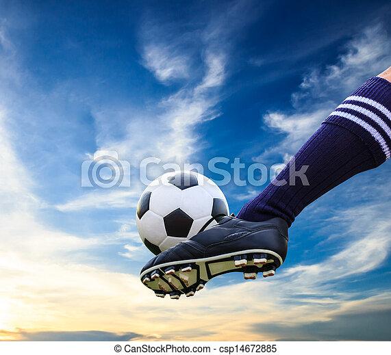 foot kicking soccer ball - csp14672885