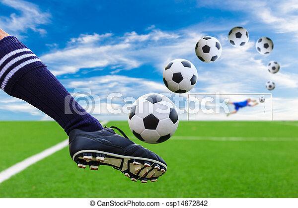 foot kicking soccer ball - csp14672842