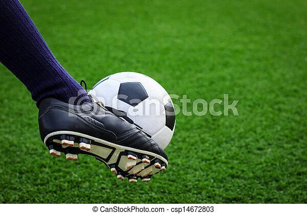 foot kicking soccer ball - csp14672803