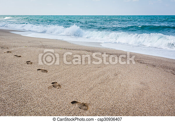 Foot print on the sand of Black Sea. Shoe prints on the beach. Seascape. - csp30936407