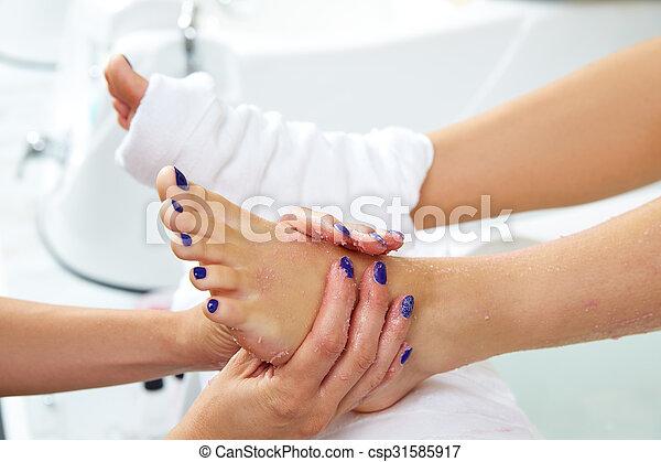 foot scrub pedicure woman leg in nail salon - csp31585917