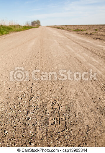 Foot Step in a dusty country road - csp13903344