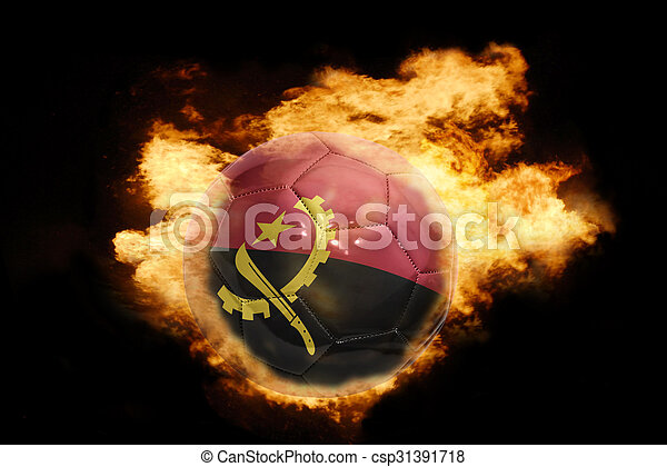 football ball with the flag of angola on fire - csp31391718