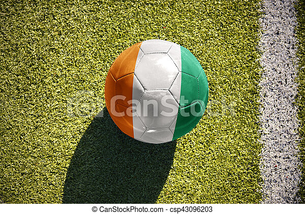 football ball with the national flag of cote divoire lies on the field - csp43096203