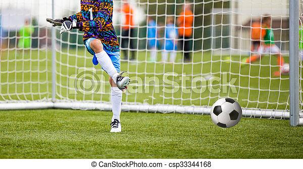 Football match for children. soccer tournament. goalkeeper save - csp33344168