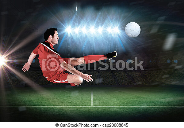 Football player in red kicking - csp20008845