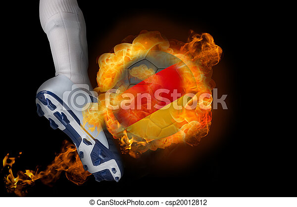 Football player kicking flaming germany ball - csp20012812