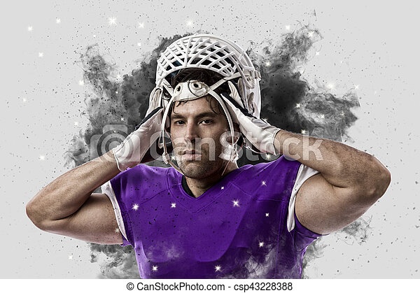 Football Player with a Purple uniform coming out of a blast of smoke - csp43228388