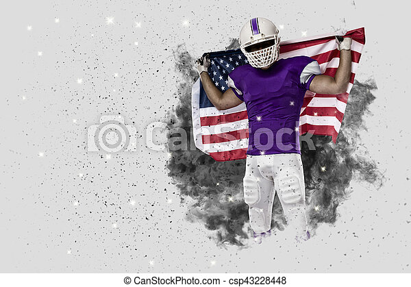 Football Player with a Purple uniform coming out of a blast of smoke - csp43228448