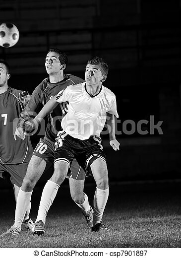 football players in action for the ball - csp7901897
