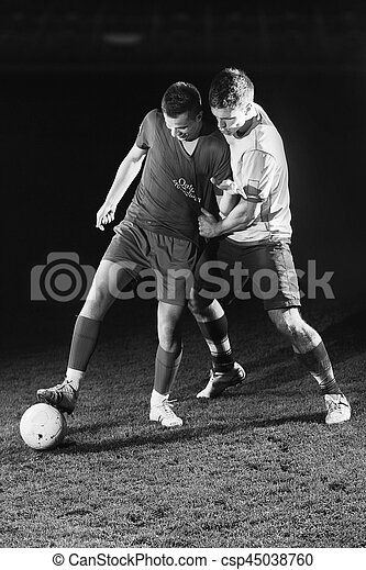 football players in competition for the ball - csp45038760