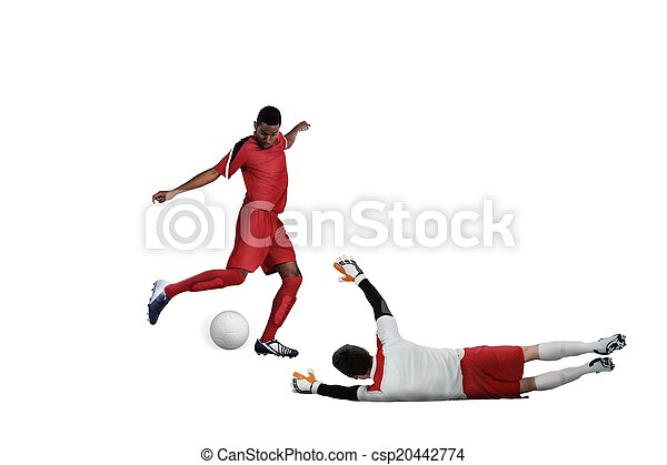 Football players tackling for the ball - csp20442774