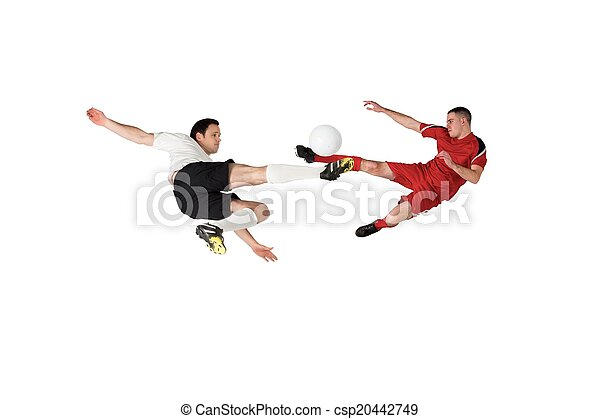 Football players tackling for the ball - csp20442749