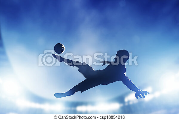 Football, soccer match. A player shooting on goal - csp18854218