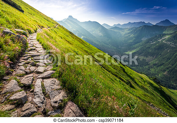 Footpath in the mountains at sunrise - csp39071184