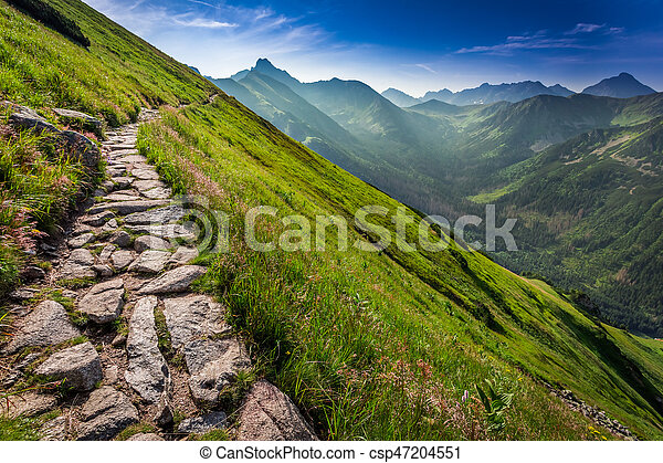 Footpath in the Tatras Mountains at sunrise, Poland, Europe - csp47204551