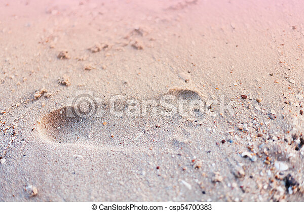 Footprint on sand in the sea beach - csp54700383