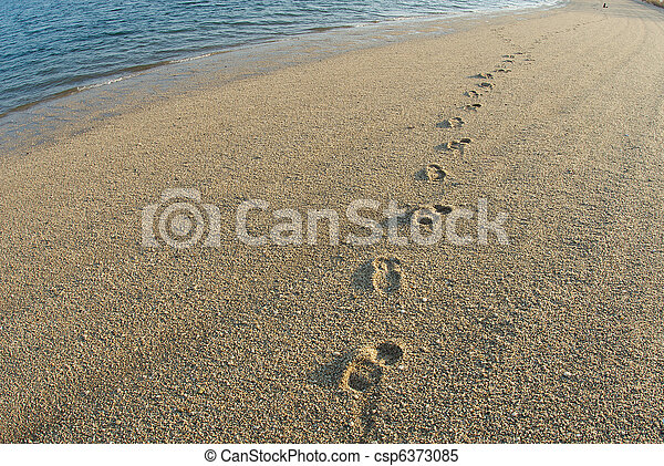 Footprints on the sand of a lonely beach - csp6373085
