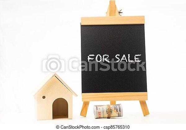 For Sale wordings on a chalkboard - csp85765310