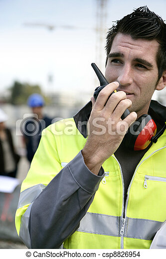 Foreman with a walkie talkie - csp8826954