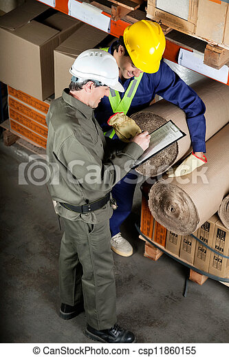 Foreman With Supervisor Writing Notes At Warehouse - csp11860155
