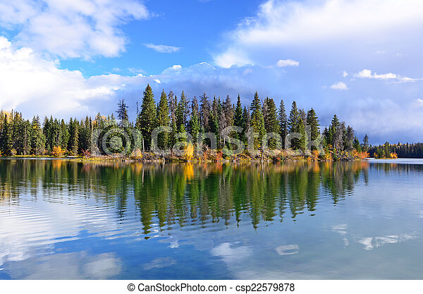 Forest and lake in autumn - csp22579878