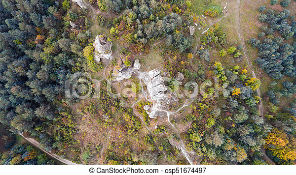 Forest and rocks in autumn aerial drone view - csp51674497