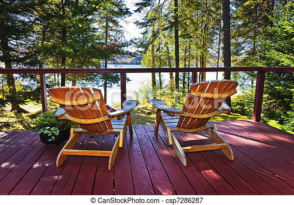 Forest cottage deck and chairs - csp7286287