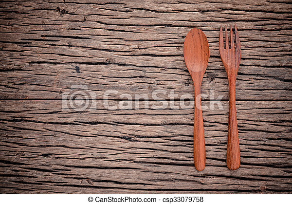 Fork and spoon on grunge wood food background concept ,menu design and  advertising campaign