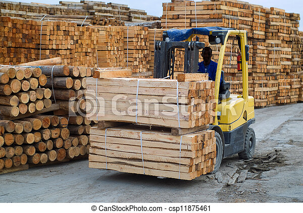 Fork lift truck in wood factory - csp11875461