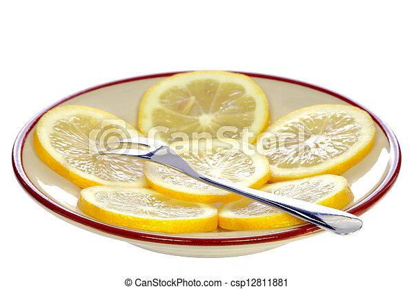 Fork on a plate with lemon - csp12811881