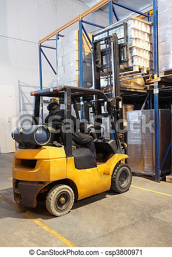 forklift loader stacking in warehouse - csp3800971